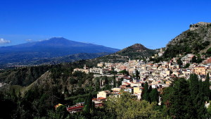 Mt_Etna_and_Taormina_as_seen_from_the_Ancient_Theatre_of_Taormina_(22290641726)